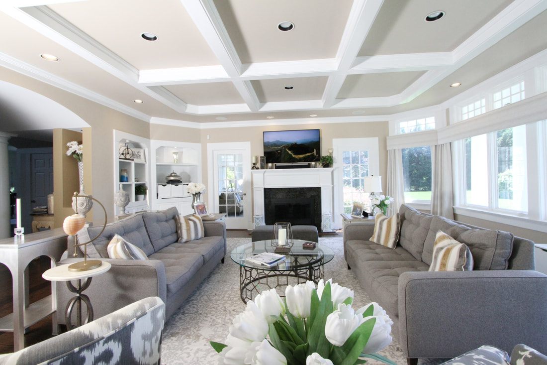 cd36c80d9 The first round of decorating began in the main home s kitchen and family  room. Soft greys and beiges with crisp white moldings and bookcases enhance  the ...
